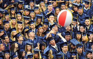 Members of the University of Maine class of 2010 keep a beachball aloft during the commencement ceremony at the Alfond Arena in Orono Saturday.  The university held two  ceremonies because of the large number of students graduating this year.  About 1700 students received their diplomas this year. BANGOR DAILY NEWS PHOTO BY GABOR DEGRE